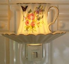 Teacup Night Light. Jean gave me one of these in blue and white. It's in my bedroom.