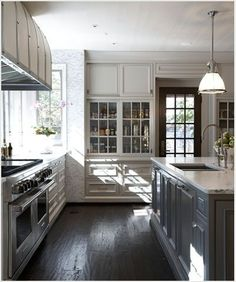 taupe upper cabinets, pewter lower cabinets, dark wood floors
