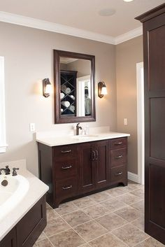 love the dark cabinets with the light marble and tile