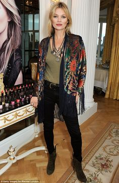 Model behaviour: Kate Moss attends the launch in kimono style jacket and skinny jeans