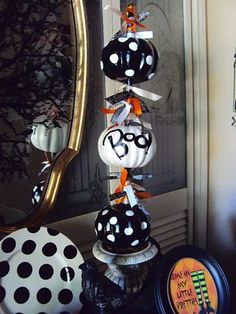 Dollar store orange pumpkins spray painted and polka dotted.  Have you ever used a marshmallow to make polka dots?  It's the best thing~~