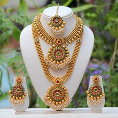 Gifts for her traditional flower design maroon kundan stone semi bridal jewelry.Antique golden traditional temple theme necklace set Choker Style and Long Gold Finish Set.This sets are comes with matching earrings &maang tikka . Bridal Necklace Set, Bridal Jewelry Sets, Wedding Jewelry, Bridal Jewellery, Bridal Sets, Gold Wedding, Wedding Bells, Wedding Bride, Wedding Events