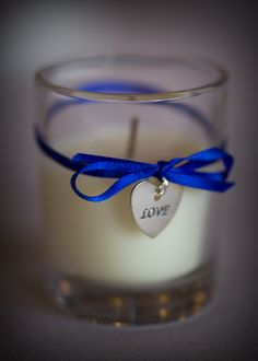 Wedding Party Favors-    Items needed:  *Glass Votive Candle Holders   *Candles   *Ribbon  *Charms  *Clear Glue   *Scissors    Instructions:  Choose candles and ribbon based on your color scheme.  Our wedding colors were royal blue (ribbon) and silver (charm).  You could also change the candle color to match.     *Tie Ribbon around glass in a double knot then add clear glue to hold in place.  Add Charm to the ribbon then tie in a bow securing the charm.