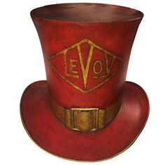 """century American painted tin trade sign in the form of a top hat. With gilt buckle, ribbon and the name """"Levoy"""" in a diamond cartouche. CIRCA: 1820 DIMENSIONS: h x w x d Vintage Tin Signs, Antique Signs, Vintage Tins, Vintage Antiques, American Paint, Old Signs, Vintage Typography, Art Furniture, Vintage Advertisements"""