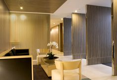 full height pivoting screens in vertical grain zebrawood - MOFO - Robarts Interiors and Architecture