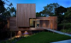The Vibe Design Group have designed this wonderful home in Kew, Melbourne with a 60's stereo cabinet inspired façade constructed of slatted timber.The house sits lightly balanced on angled steelposts again reminiscent of the stereo cabinet legs, which affords the house theappearance of floating outacross the land.    http://www.facebook.com/DesignerMelbourne
