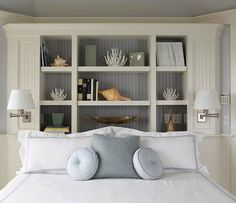Love this bookcase behind the bed! This is what we need! Adds height, eliminates the need for nightstands!