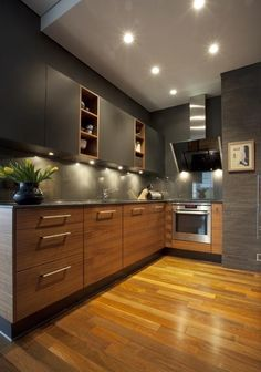 Wooden L - Shaped Modular Kitchen with Upper Cabinets highlighted with Spot Lights - GharPedia Kitchen Room Design, Kitchen Cabinet Design, Modern Kitchen Design, Interior Design Kitchen, L Shaped Kitchen Interior, L Shape Kitchen, L Shaped Modular Kitchen, L Shaped Kitchen Designs, Latest Kitchen Designs