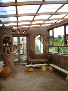 Cob greenhouse....maybe do this as an addition to the main structure?