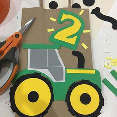 This is a handmade Tractor bag to put favors inside. The bag design is inspired by a farmers tractor. The bag is a kraft recycle brown lunch style. I glued the design on the front of the bag. The design is a compilation of high quality card stock paper, the character has different