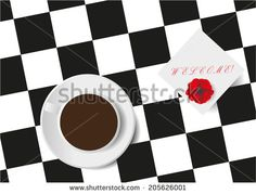 Cup from coffee on a table with a square pattern, and paper with the phrase…
