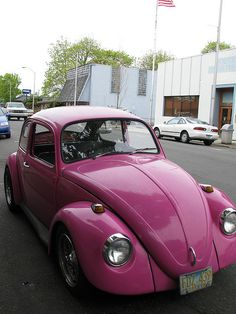 Pink VW Bug! I want!!!! Only I want mine light sparkly pink & a white fuzzy steering wheel && a disco ball hanging from the rear view window :-)