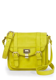 STEVE MADDEN Locks Crossbody Faux leather crossbody Back metal nameplate embellishment Exterior slip pocket Tonal topstitch detailing Foldover flap features decorative buckles and clasp closure Adjustable shoulder strap Lined interior features two slip pockets and one zip pocket Gold-tone hardware Flat bottom design $59.99