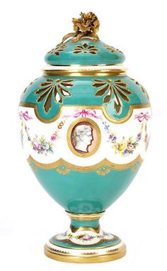 A Minton pot-pourri vase and cover, circa 1860-70 The ovoid body with pierced decoration above a garland of flowers enclosing oval portrait vignettes, on a green ground, the cover pierced and with a flower finial
