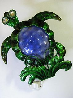 Sea Turtle Night Light from Astral Avenues; Whimsical nautical decor; Provides the comfort of soft illumination that leads to peaceful sleep and lightens dark hallways; Great baby shower gift; Get safety, security and a beautiful home accent now! http://www.amazon.com/dp/B011GVW3LA/ref=cm_sw_r_pi_dp_jwN3vb04S5XCB