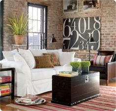 Love the textured brick walls and slipcovered couch