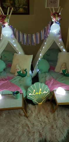 Our Mermaid Magic package comes with the option of 1-6 teepees. Each teepee has floral and light decorations, air bed, pillow, sheet, duvet, a shell cushion and a mermaid cushion. Our special shimmering mermaid tail blankets will transform you into a mermaid as you snuggle into your teepee. Every teepee comes with a table to store your sleepover essentials, a night light and a mermaid mug. Extra lights, decorations and buntings are also included. Book now for an undersea adventure! Teepee Kids, Teepees, Kids Furniture, Plywood Furniture, Furniture Design, Teepee Party, Mermaid Mugs, Mermaid Tail Blanket, Wedding Art