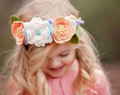 A felt flower headband of luxurious features including, gold glitter floral centre, faux gold leather and gold glitter leaves, and 2 intricate rose buds. This headband from the Strawberry Vanilla Swirl flavour set truly distinguishes the Decadent Desserts Collection. Finished with a thick nylon band that fits most head sizes, including adults, yet the most soft and cozy for your littlest peach.