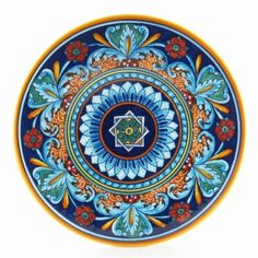 This splendid wall plate has been painted for our collection by Eugenio Ricciarelli, a ceramic artist whose gifted hand gives life to some of the most beautiful geometric patterns in Deruta. A natural talent nurtured by the most Deruta's skilled masters, Eugenio worked for many years at the famous Franco Mari's majolica factory. Today he owns his small snug workshop, established 15 years ago, where, with the help oh his sister in law and his niece, he paints with ceaseless passion his…