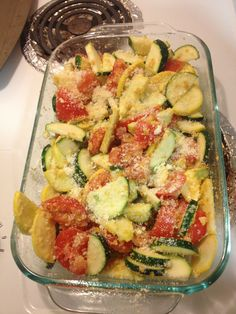 Easy veggie dish-- mix together in a casserole dish--olive oil, parm cheese, sliced zucchini, sliced summer squash, chopped tomatoes, a few chopped green onions, crushed corn flakes (instead of bread crumbs), chopped garlic & a little fresh ground pepper. Bake for 30 minutes at 350. Yummy!