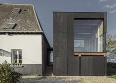 Blackened timber reading room extends a coastal home in northern France.