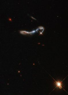 Cinderella's Slipper Galaxy?  Visible as a small, sparkling hook in the dark sky, this beautiful object is known as J082354.96+280621.6, or J082354.96 for short. It is a starburst galaxy, so named because of the incredibly (and unusually) high rate of star formation occurring within it.   Hat tip to Phil Plait and his fans for noticing the galaxy and giving it a cool name.  Image: ESA/Hubble & NASA, M. Hayes [high-resolution]  Caption: Hubble Heritage Team