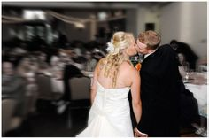 Bride and Groom kiss during Black Bear Golf Club reception