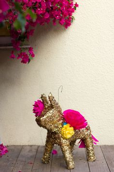 DIY Gilded Paper Flower Pinata- customize with metallic spray paint and crepe paper flowers (love it!)