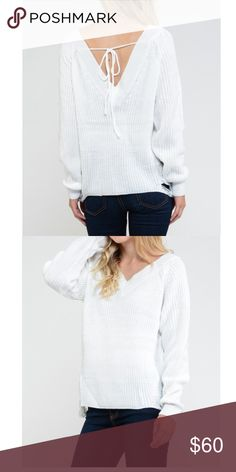 Winter white distressed sweater💕 V neck tie back distressed on bottom sides sexy and comfy! Fits s/m or m/l Sweaters