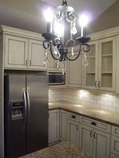 Antique White Cabinets Black Appliances antique white cabinets, stainless steel 5 burner stove, stainless