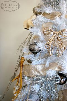 love this white tree with silver branches and gold glitter antlers silver christmas christmas