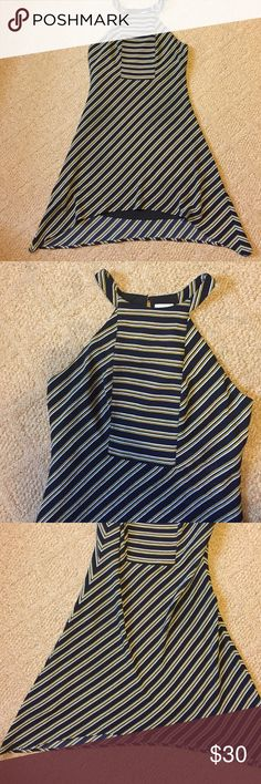 Asymmetrical navy striped dress, size S Navy dress with gold, white stripes. Very flattering. Size S, hand wash line dry PIXLEY Dresses Asymmetrical