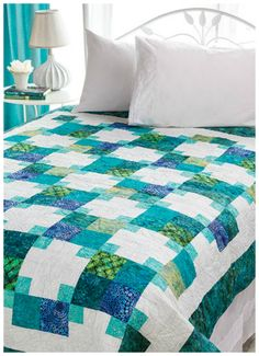 """Grandma's Victory Quilt Pattern. Try a monochromatic color palette of blues to create a soothing day-at-the-beach quilt. Finished size is 63"""" x 79""""."""
