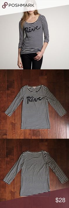 """J. Crew Drapey Rêve Tee This cute sequenced tee is featured with long sleeves that are navy & off-white stripes. Perfect with a pair of jeans. The text has little black sequins on it and says """"Rêve,"""" which means dream in French, 60% cotton, 25% modal, 15% linen. In great condition! J. Crew Tops"""
