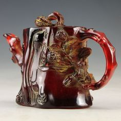 carved amber teapot