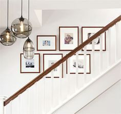 Learn how to create a modern frame wall. See inspiring arrangements and get simp… Learn how to create a modern frame wall. See inspiring arrangements and get simple tips for hanging a personal gallery wall. Staircase Frames, Staircase Pictures, Stairwell Wall, Staircase Wall Decor, Stairway Decorating, Stair Photo Walls, Stairway Gallery Wall, Photowall Ideas, Frames On Wall