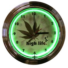 """HIGH LIFE NEON CLOCK-NN8HIGHL  15"""" wide, 15"""" high, 3"""" deep  Even people who live a recreational lifestyle need to know what time it is. Keep track with the High Life Neon Clock! Generating 25 watts of illumination from a hand blown ring of neon glass, the High Life Neon Clock has a glass face and either black or chrome finished rim in a multi-tiered, art deco style."""