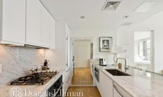 Mirror on end wall of kitchen really opens up the small space The model Gigi Hadid has listed her 25 million NYC apartment Five room 935 sq ft on trendy Bowery Kitchen Marble, Celebrity Houses, Home, Gigi Hadid Apartment, Cool Apartments, Soho Apartment, Apartment Kitchen, Bathrooms Remodel, New York Apartment