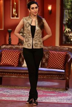 Karisma Kapoor wearing a Ritika Mirchandani vest and Mrinalini Chandra earrings. Simple Kurti Designs, Kurti Neck Designs, Blouse Designs, Casual Blazer Women, Embroidery Suits Design, Indian Designer Outfits, Classy Outfits, Indian Wear, Fashion Outfits