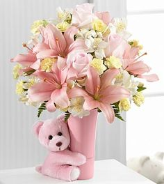 FTD Baby Girl Big Hug Bouquet - PREMIUM  Price: 57.90    The FTD Baby Girl Big Hug Bouquet is a sweet and adorable way to congratulate the new family!