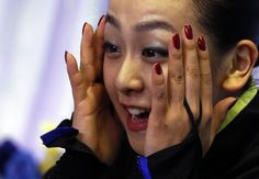 Asada of Japan reacts to her score after performing during the women's free skating programme at the ISU Grand Prix of Figure Skating in Tok...