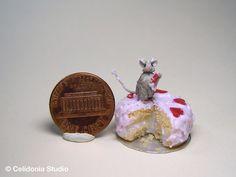 miniature mouse on cake