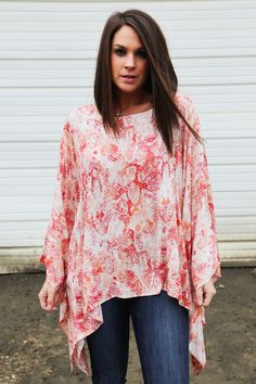Shades of red, coral, and ivory. Loose fitting, poncho! Rayon. Model is a 2/3, wearing a small. Please note this poncho is meant to fit loose, and flowy! Small 2-6/7, Medium 8-10/12, Large 14-16