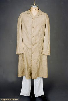 1880 Man's Duster  Unlined, three patch pockets, six center front self fabric buttons, center back hem slit, machine sewn.