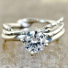 We love rustic engagement rings, with skinny bands twisted to look like tree branches. How pretty is this guy?