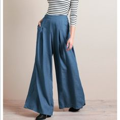 High waisted wide leg flares Brand new still in packaging. Size medium. 4-8 could fit due to the nice stretch. Gorgeous flowy wide leg. Firm on price since these have never been worn. Pants Wide Leg