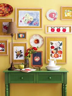 Displaying Art: Eclectic Collections + Gallery Walls  Love the colors here...I like the bright effect of the yellow wall, and the green furniture against it.  Would also look great with furniture in blues, reds, turquoise, orange...any bright--but darker than yellow-color.