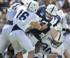 PENN STATE – FOOTBALL 2014 – BLUE/WHITE GAME, APRIL 12, 2014 – Penn State tight end Jesse James is brought down cornerback Devin Pryor and linebacker Charles Idemudia during the annual Blue-White game, April 12, 2014, at Beaver Stadium. Joe Hermitt, PennLive