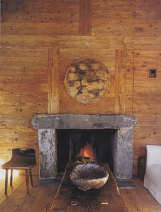 Simple and understated fireplace at a Swiss ski chalet. #magazinecutouts