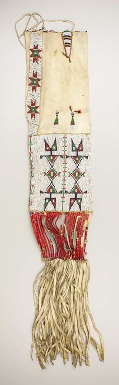 A SIOUX BEADED HIDE TOBACCO BAG. . c. 1890. ... American Indian | Lot #77156 | Heritage Auctions